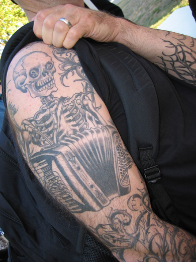 andrew's skull and accordion tatoo