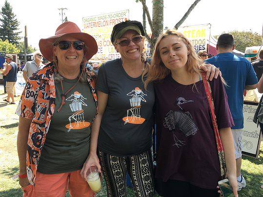 Three generations of beautiful women in Mad Maggies shirts at the Cotati Accordion Festival, California 2016